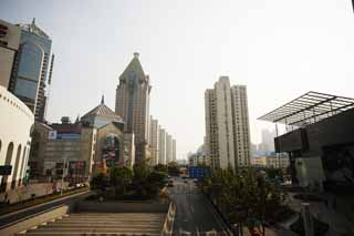 photo,material,free,landscape,picture,stock photo,Creative Commons,Row of houses along a city street of Shanghai, high-rise building, road, car, store